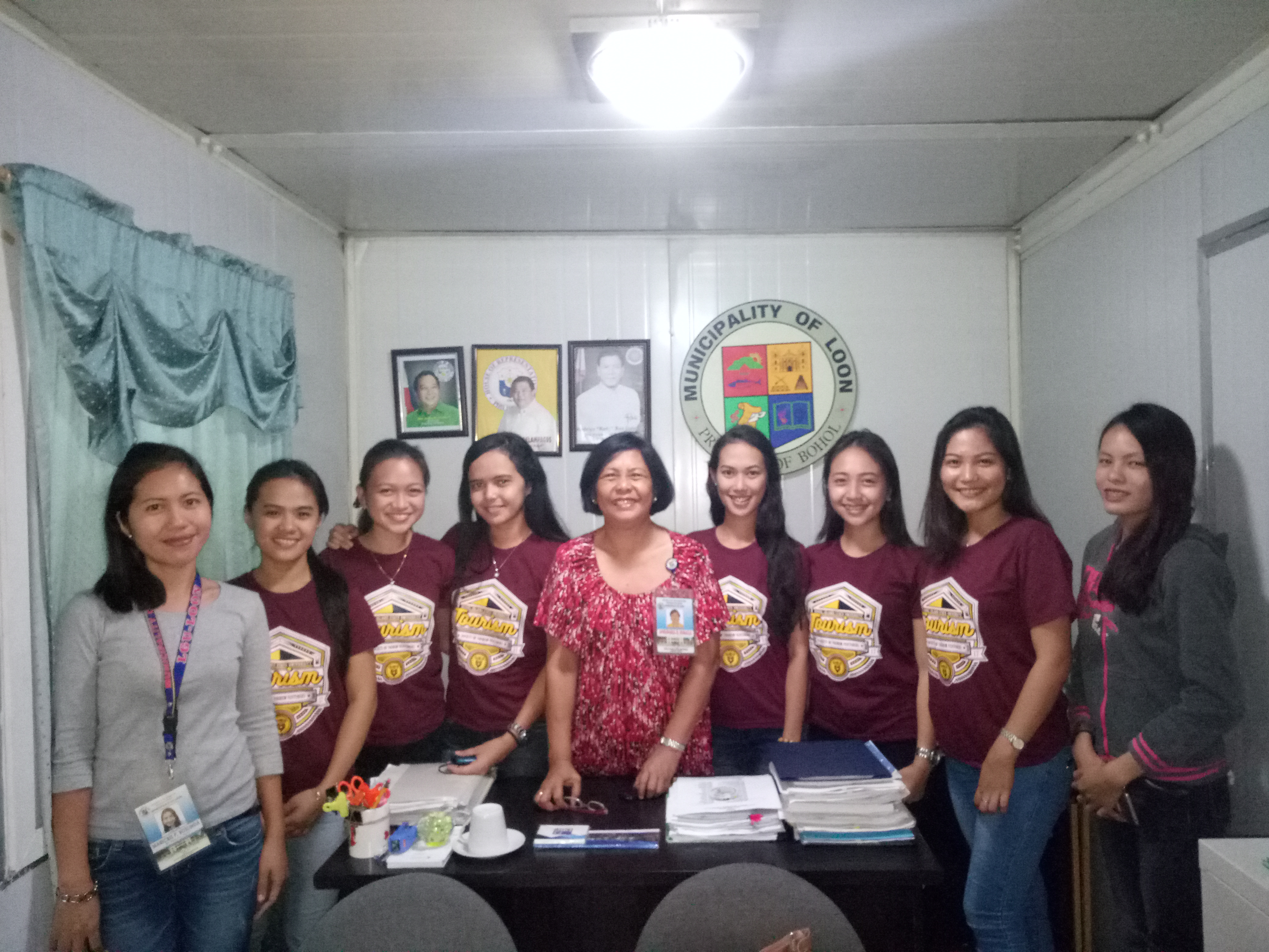 The Tourism students together with Apolinaria R. Guballa, Executive Assistant to the Mayor (Middle), Maricris Roslinda (Left) and the Tourism students: L-R: Krystil Jane Pacot, Angelica Mae Mawi, Azel Rose Indino, Christine Joy Mahumot, Ginaelle Idulsa, Jerrylyn Ampasin, Ashley Camille Bayron.